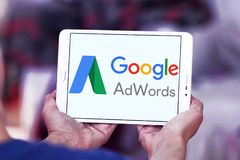 Google AdWords logo. Logo of Google AdWords on samsung tablet . Google AdWords is an online advertising service developed by Google, where advertisers pay to Royalty Free Stock Image