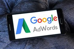Google AdWords logo. Logo of Google AdWords on samsung mobile. Google AdWords is an online advertising service developed by Google, where advertisers pay to Stock Photo