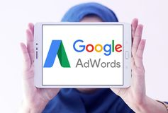 Google AdWords logo. Logo of Google AdWords on samsung tablet holded by arab muslim woman. Google AdWords is an online advertising service developed by Google Stock Photos