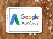 Google AdWords logo. Logo of Google AdWords on samsung tablet on wooden background. Google AdWords is an online advertising service developed by Google, where Stock Photo