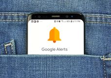 Google Alerts on a phone screen in a pocket. MONTREAL, CANADA - OCTOBER 4, 2018: Google Alerts on s8 screen. Google Alerts is a content change notification stock image