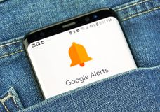 Google Alerts on a phone screen in a pocket. MONTREAL, CANADA - OCTOBER 4, 2018: Google Alerts on s8 screen. Google Alerts is a content change notification stock photo