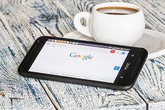 Google app open in the mobile phone HTC Royalty Free Stock Images