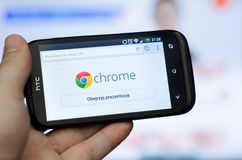 Google Chrome mobile web browser. Hand holding smartphone with Google Chrome mobile web browser stock images