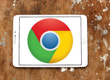 Google chrome web browser logo. Logo of google chrome web browser on samsung tablet on wooden background royalty free stock photography