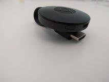 Google Chromecast 2 vitbakgrund Royaltyfria Foton
