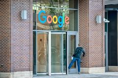 Google Corporate Office building in Fulton Market. Main street in Chicago. Illinois business. Fulton Market, Chicago-May 4, 2019: An employee entering the front stock images