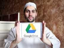 Google Drive logo. Logo of Google Drive on samsung tablet holded by arab muslim man. Google Drive is a file storage and synchronization service developed by Stock Photography