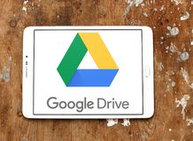 Google Drive logo. Logo of Google Drive on samsung tablet on wooden background. Google Drive is a file storage and synchronization service developed by Google stock photography