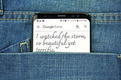 Google Fonts on a phone screen in a pocket. MONTREAL, CANADA - OCTOBER 4, 2018: Google Fonts on s8 screen. Google Fonts is a library of licensed fonts. Google is royalty free stock images