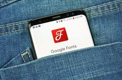 Google Fonts on a phone screen in a pocket. MONTREAL, CANADA - OCTOBER 4, 2018: Google Fonts on s8 screen. Google Fonts is a library of licensed fonts. Google is stock photos
