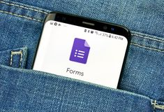 Google Forms on a phone screen in a pocket. MONTREAL, CANADA - OCTOBER 4, 2018: Google Forms app on s8 screen in a pocket of a blue jeans. Google is an American stock images