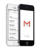 Google Gmail app and Gmail inbox on white and black Apple iPhones. Varna, Bulgaria - May 26, 2015: Google Gmail app logo and Gmail inbox on the white and black Stock Images