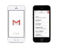 Google Gmail app and Gmail inbox on white and black Apple iPhones. Varna, Bulgaria - May 26, 2015: Google Gmail app logo and Gmail inbox on the front view white stock images