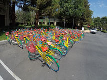 Google Headquarters. MOUNTAIN VIEW, CA - AUGUST 1, 2015: Bikes used by Google employees to navigate Google headquarters, also known as Googleplex, in Mountain Royalty Free Stock Images