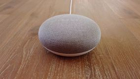 Google Home Mini - Mini Smart Home Voice Assistant Controlled Gadget Responding To Command stock video