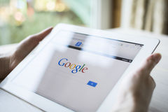 Google on ipad Stock Photography