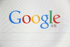 Google Logo with Chinese word. Computer screen with Google logo with Chinese word closeup stock photos