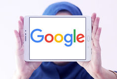 Google logo. Google company logo and vector on samsung tablet holded by arab muslim woman stock photos