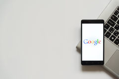 Google logo on smartphone screen. Bratislava, Slovakia, April 28, 2017: Google logo on smartphone screen placed on laptop keyboard. Empty place to write Stock Photography