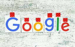 Google logotype taped with red adhesive tape on old wood stock illustration