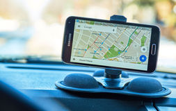 Google Maps application. MONTREAL, CANADA - FEBRUARY, 2016 - GPS application Google Maps, running on Samsung S5 in a car. Google Maps is one of the most popular Stock Photo