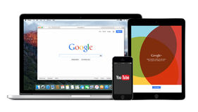 Google multi devices with Google search YouTube and Google Plus. Google products multi devices set with web Google search on Apple Macbook Pro, YouTube app on Royalty Free Stock Image