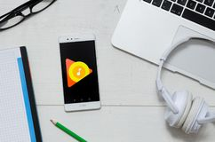 Google Music is a service that offers streaming music. WROCLAW, POLAND - MARCH 29, 2018: Google Music is a service that offers streaming music. Smartphone with stock photos