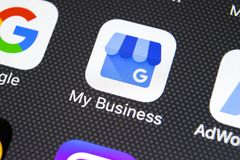 Google My Business application icon on Apple iPhone X screen close-up. Google My Business icon. Google My business application. Sankt-Petersburg, Russia royalty free stock image