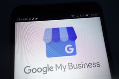 Google My Business logo on smartphone. KONSKIE, POLAND - SEPTEMBER 22, 2018: Google My Business logo on smartphone stock photo