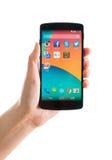 Google Nexus 5 in hand Royalty Free Stock Image