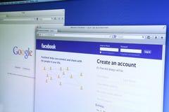 Google och Facebook website Arkivfoto