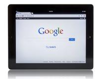 Google op iPad 3 Stock Afbeeldingen