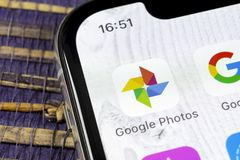 Google Photos plus application icon on Apple iPhone X screen close-up. Google plus Photos icon. Google photos application. Social. Sankt-Petersburg, Russia royalty free stock image