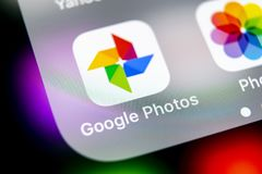 Google Photos plus application icon on Apple iPhone X screen close-up. Google plus Photos icon. Google photos application. Social. Sankt-Petersburg, Russia royalty free stock images