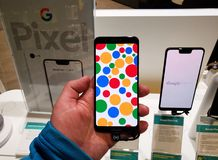 Google Pixel 3 phone in a hand. MONTREAL, CANADA - MARCH 28, 2019: Google Pixel 3 phone in a hand at mobile store. Google Pixel is a line of electronic devices stock photos