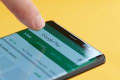 Google play menu on smartphone screen stock image