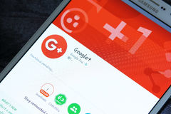 Google plus app on google play. Downloading google plus application on google play on samsung tab s2 Stock Photo