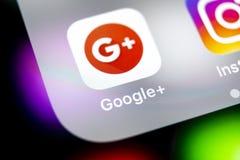 Google plus application icon on Apple iPhone X smartphone screen close-up. Google plus app icon. Google+. Social media icon. Socia. Sankt-Petersburg, Russia stock photo