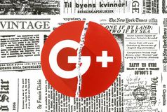 Google plus icon torn and put on retro newspaper royalty free stock photos
