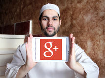 Google Plus logo. Google Plus application logo and vector on samsung tablet holded by arab muslim man stock image