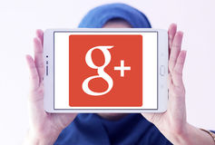 Google Plus logo. Google Plus application logo and vector on samsung tablet holded by arab muslim woman royalty free stock photo
