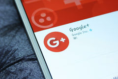 Google plus mobile app. Downloading google plus mobile application from google play store on samsung tablet stock images