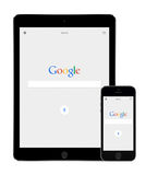 Google search app on the Apple iPad Air 2 and iPhone 5s displays Stock Images
