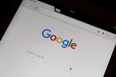 Google search in google chrome frontpage on an iPad Air. Close-up Stock Image
