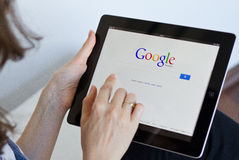 Google search. Woman performs a Google search on digital tablet Royalty Free Stock Photos