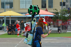 Google Street View camera operator at work. AUCKLAND - DEC 02 2015:Google Street View camera operator at work.It's a technology featured in Google Maps and Stock Image