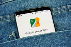 Google Street view on a phone screen in a pocket. MONTREAL, CANADA - OCTOBER 4, 2018: Google Street view app on s8 screen. Google is an American technology royalty free stock photography