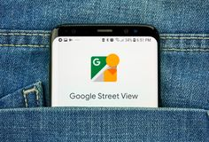 Google Street view on a phone screen in a pocket. MONTREAL, CANADA - OCTOBER 4, 2018: Google Street view app on s8 screen. Google is an American technology stock image