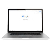 Google-webpagina op de provertoning van Macbook Stock Fotografie